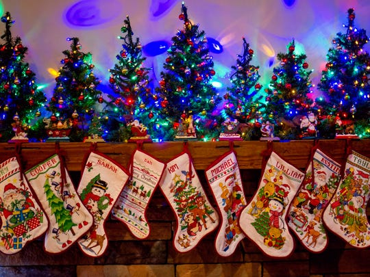 Christmas enthusiast Kim Lynch hand makes needlepoint Christmas stockings for each of her family members.