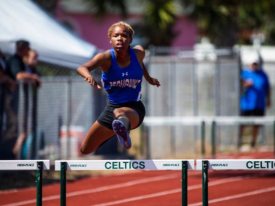 Loren Brown, of the Community School of Naples, competes in the 300m hurdles during the Class 1A District 8 track and field meet at St. John Neumann Catholic High School on Tuesday, April 17, 2018.