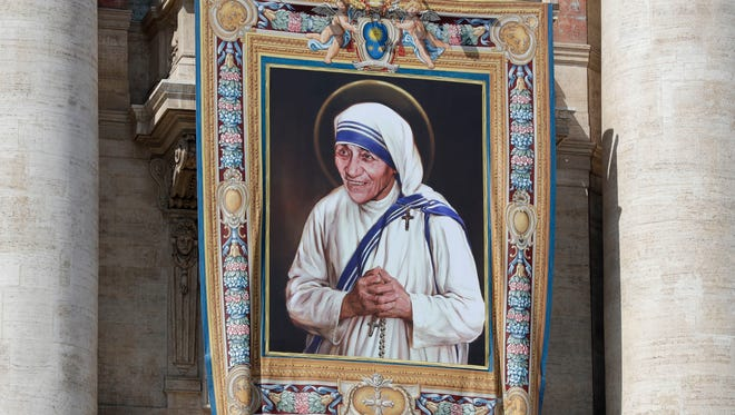 A tapestry picturing Mother Teresa hangs from the central balcony of St. Peter's Basilica, in St. Peter's Square at the Vatican
