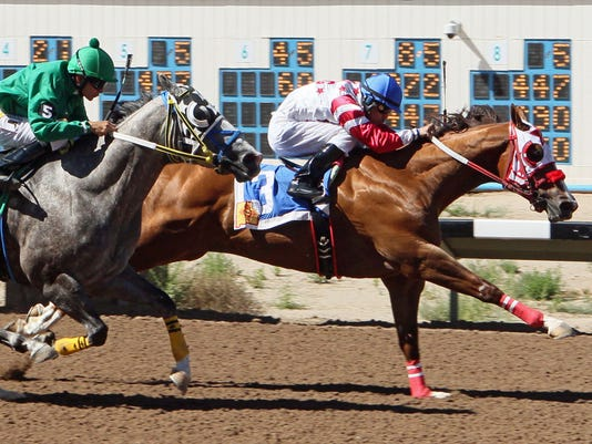 Grant The Star, ridden by Adrian Ramos, prevails over Sc Dustychampion in the $45,000 Jimmy Drake Stakes, one of two stakes races on the Sunday program at SunRay Park and Casino in Farmington.