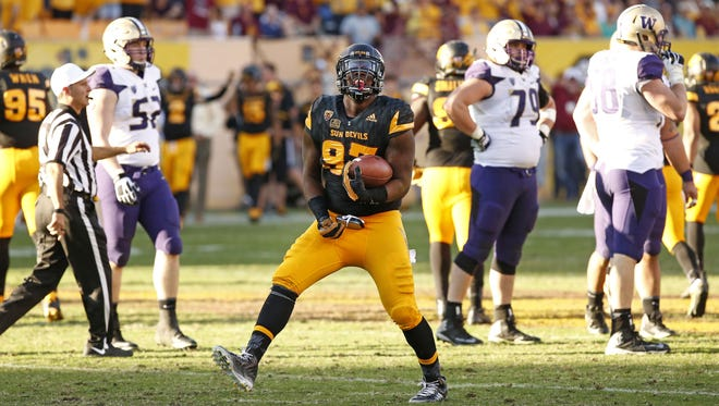 ASU's Edmond Boateng (97) recovers a Washington fumble in the fourth quarter on Nov. 14, 2015 in Tempe, Ariz.