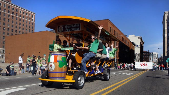 The Great Lakes Pub Cruiser rides in the Grand Rapids St. Patrick's Day parade. The minivan-size pedicab has a top speed of 5 m.p.h. Pedicabs are popular in a few Michigan cities and some resort areas nationwide.