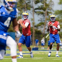UD quarterbacks Blake Rankin (7) and Joe Walker (3) practice.
