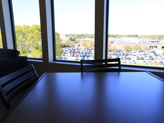 A table in a student lounge overlooks campus at Northeast