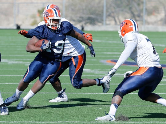 UTEP running back Treyvon Hughes weaves his way through the UTEP defense during the teams practice on Wednesday morning held at Glory Field.