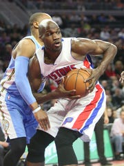 Detroit Pistons center Joel Anthony rebounds against
