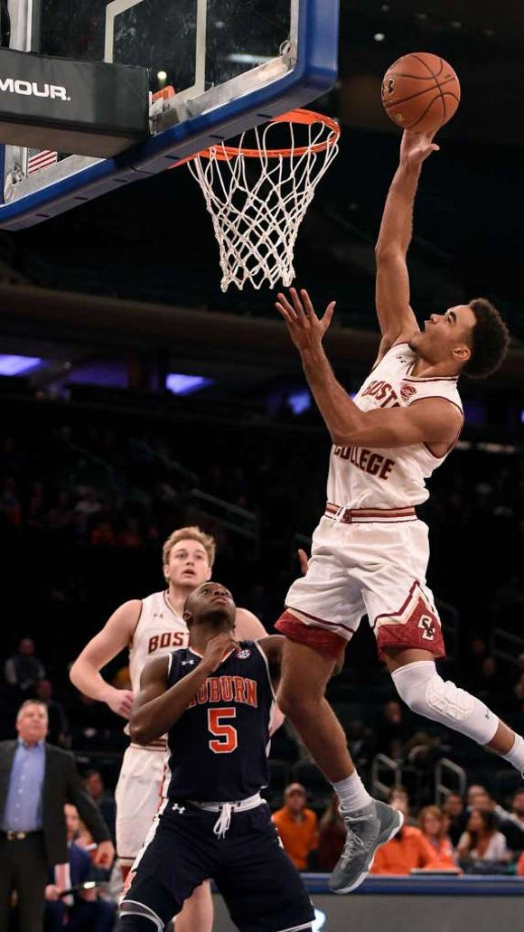 Boston College Jerome Robinson drives the ball to the basket over Auburn guard Mustapha Heron (5) in the first half of an NCAA college basketball game, Monday, Dec. 12, 2016, in New York.