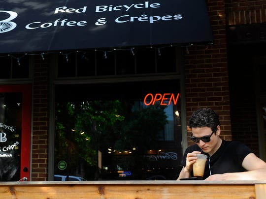 Christopher Cruz enjoys a coffee at Red Bicycle Coffee