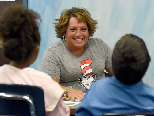 Tekoppel Elementary School teacher Ange Dierks works with students in a guided reading rotation at the school in Evansville Wednesday.  Dierks has worked 26 years with the Evansville Vanderburgh School Corp., 23 of those have been at Tekoppel.