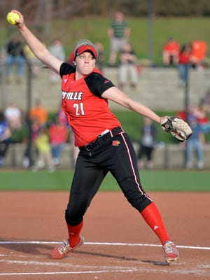 Louisville's Maryssa Becker pitches in to the Kentucky side during their game at Ulmer Stadium in Louisville, Ky., Wednesday, April 1, 2015.