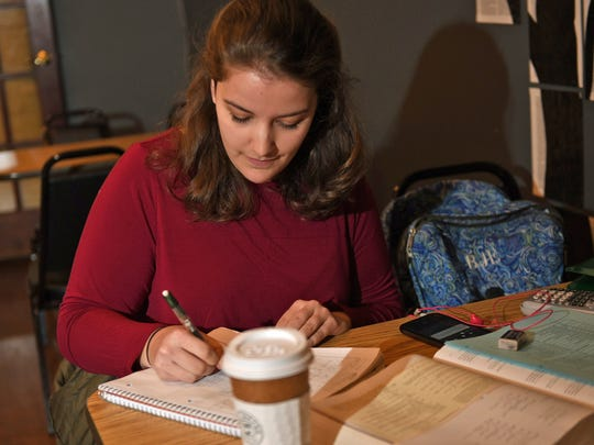 Rebekah Edwards, an Eastern University student, studies for an exam while on break Friday, March 3, 2017 in a Downtown Chambersburg coffee shop. Edwards talked to reporters about her opinion of the Trump administration and recent issues involving Russia.