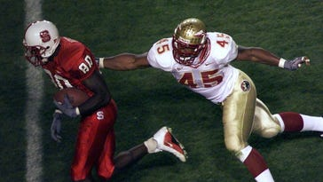 Darnell Dockett attempts to tackle N.C. State receiver Willie Wright.