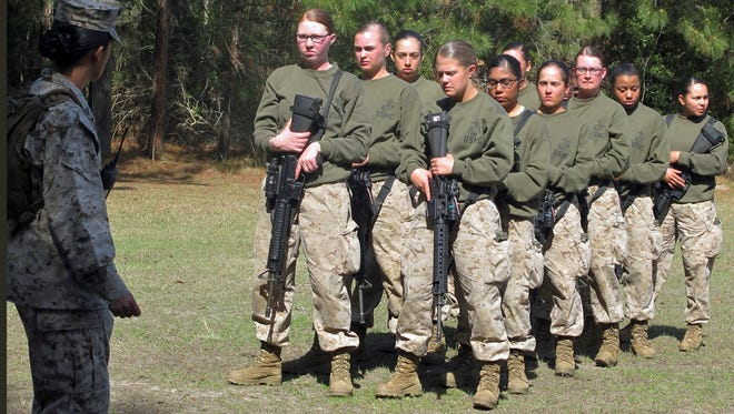 In this Feb. 21, 2013 file photo, female recruits stand at the Marine Corps Training Depot on Parris Island, S.C. The U.S. Marine Corps for the first time is eyeing a plan to let women attend what has been male-only combat training in Southern California.
