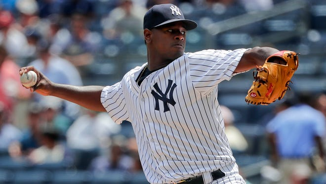 Yankees pitcher Luis Severino delivers against the Reds during the first inning Wednesday in New York.