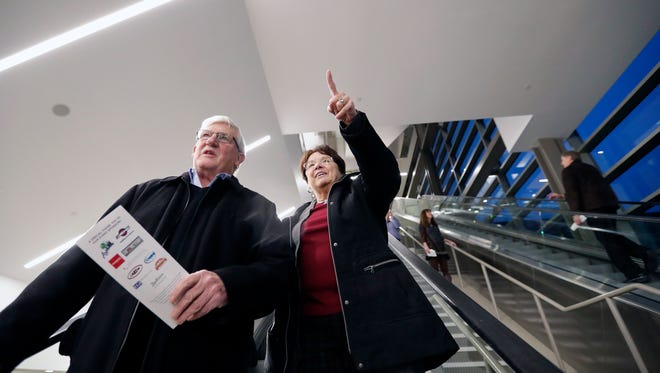 """Dennis and Mary Ann Wepfer of Fox Crossing get their first look at the completed Fox Cities Exhibition Center during a grand opening event Thursday in Appleton. """"This is a dream come true,"""" said Mary Ann Wepfer."""