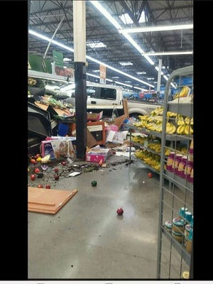 A photo that Sharon Cook-Wisse took inside the Pella Wal-Mart on Thursday after a pickup truck crashed through the front doors.