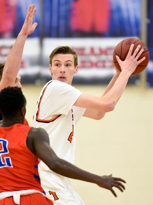 St. Cloud Tech's Trevor Koenig look for a way around St. Cloud Apollo's Luke Dunsmoor and Abdihakim Shukri, 2,       during the first half Tuesday, Jan. 10, at Apollo.