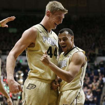 Purdue Boilermakers center Isaac Haas and teammate