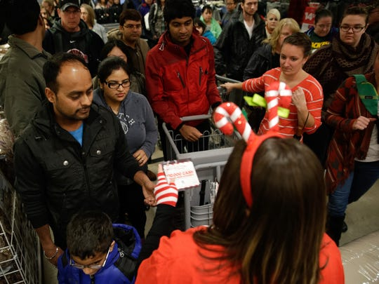 Shoppers receive coupons as they enter JCPenney.