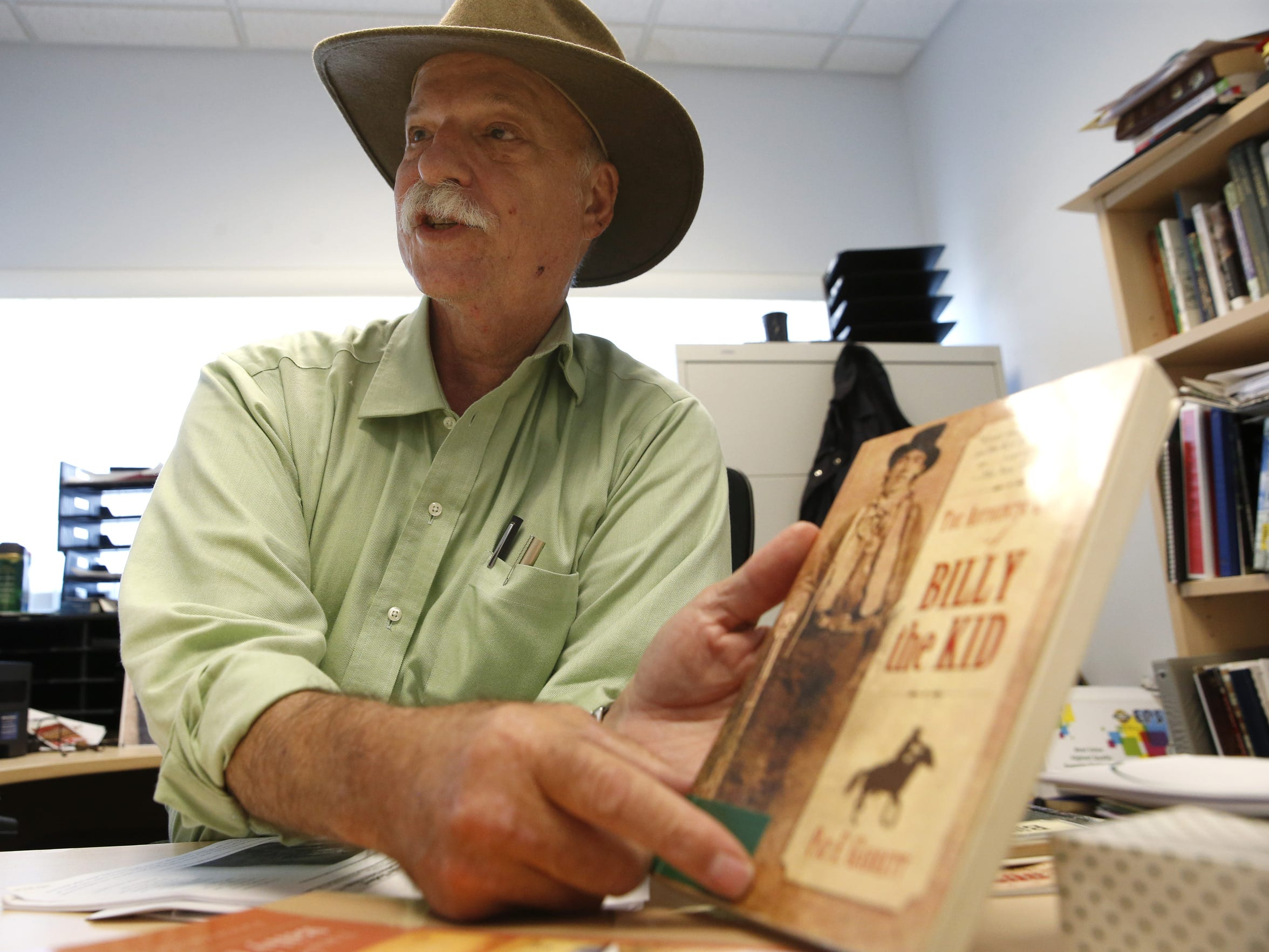 Dr. Michael Abrams speaks from his office at FAMU's campus Wednesday about some of the research he has done to verify a tintype photograph he believes to be an original of outlaw Billy the Kid. There are only two known, verified photos of the outlaw known to be in existence.