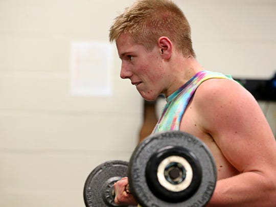 Riley Walker works out in the school's weight room.