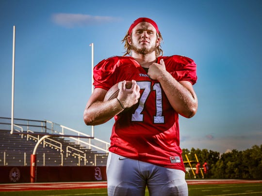 Center Grove's Clay Hadley helped clear the way for the Trojans' devastating rushing attack.