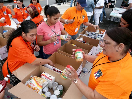 Volunteers sort through donations of food, medicine