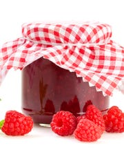 Raspberry Jam Jar with red checkered cloth isolated