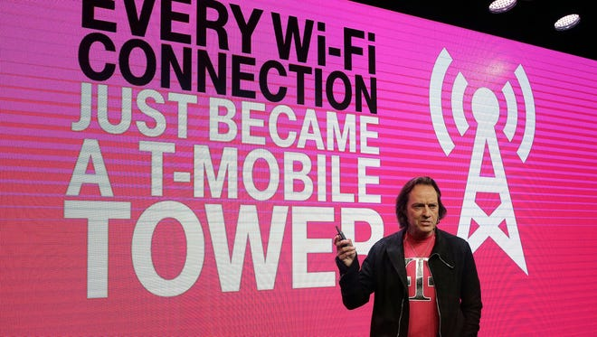 T-Mobile CEO John Legere speaks at a T-Mobile announcement in San Francisco, Wednesday, Sept. 10, 2014. T-Mobile will sell more than 100 smartphone models with a built-in feature that taps into Wi-Fi networks to make phone calls and send texts when customers can't connect to the wireless carrier's cellular network.