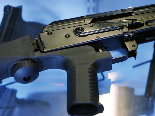 """A device called a """"bump stock"""" is attached to a semi-automatic"""