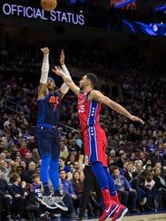 Oklahoma City Thunder's Carmelo Anthony, left, shoots