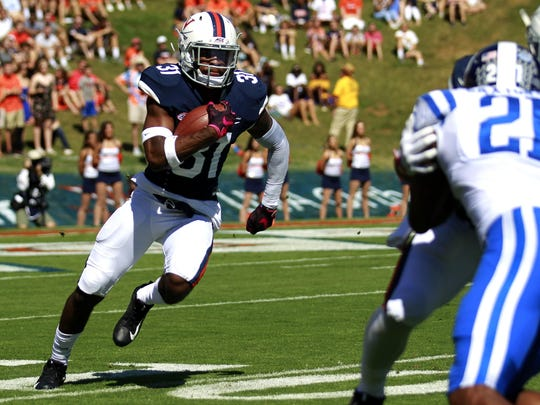 Virginia's Chris Sharp (31) carries the ball up field at the start of a drive in the first half against Duke on Saturday, Oct. 7, in Charlottesville.
