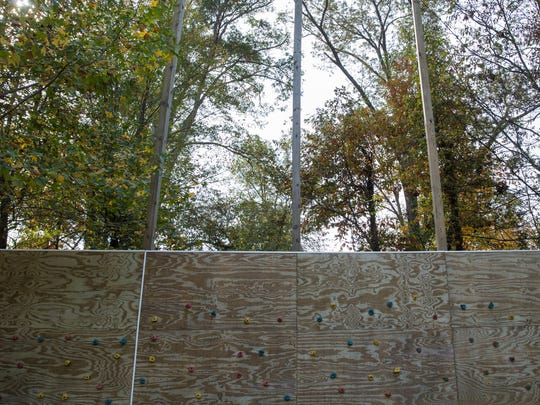 Construction on a 30 foot rock climbing wall is underway on Monday morning at the Brain Injury Adventure Camp in Robards, Kentucky.