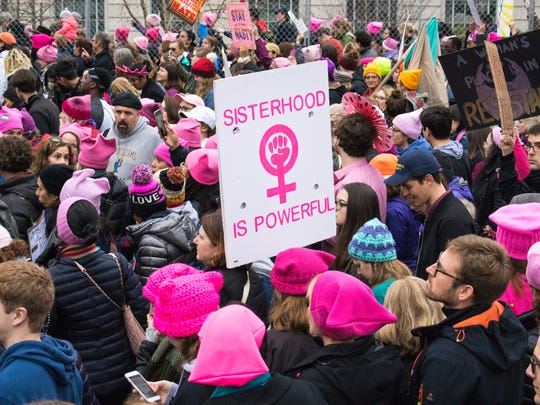 A sea of pink and homemade signs floods downtown D.C. streets at the Women's March on Washington the day after Donald Trump's inauguration as president in 2017.