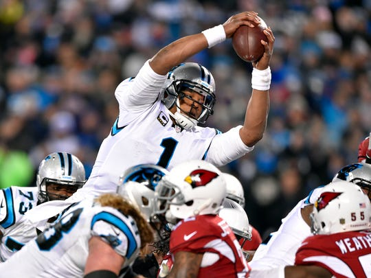 Jan 24, 2016; Charlotte, NC, USA; Carolina Panthers quarterback Cam Newton (1) dives for a touchdown during the second quarter against the Arizona Cardinals in the NFC Championship football game at Bank of America Stadium. Mandatory Credit: Bob Donnan-USA TODAY Sports