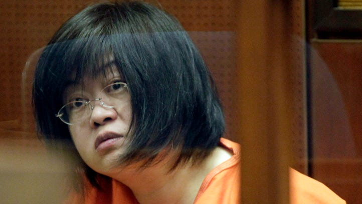 """In this March 16, 2012 file photo Dr. Hsiu-Ying """"Lisa"""" Tseng sits in a Los Angeles courtroom during her arraignment."""