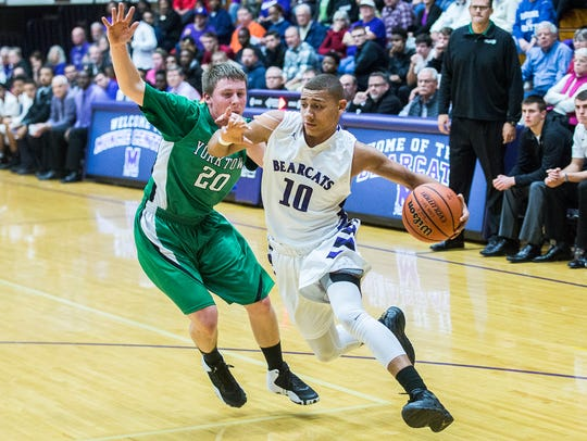 Central's Jamel Barnes dribbles past Yorktown's Sullivan