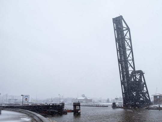 The former Pere Marquette railroad bridge at the mouth of the Black River is cloaked by a wet snow March 1.