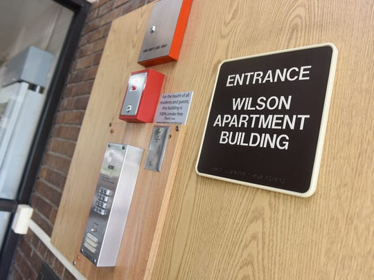 A sign marks the entrance to Wilson Apartments Thursday, May 24, in St. Cloud.