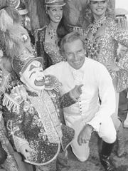 "FILE - In this July 19, 1978 file photo, actor Charlton Heston is shown with Ringling Bros. and Barnum and Bailey Circus clown Prince Paul during the City of Hope's Celebrity Circus opening in Inglewood, Calif. The Ringling Bros. and Barnum & Bailey Circus will end ""The Greatest Show on Earth"" in May 2017, following a 146-year run of performances. Kenneth Feld, the chairman and CEO of Feld Entertainment, which owns the circus, told The Associated Press when the company removed the elephants from the shows in May of 2016, ticket sales declined more dramatically than expected."