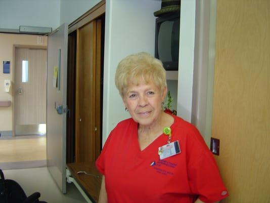 635796525474246171-Pastor-Dan-cleaning-lady-2004-in-St.-Joe-s