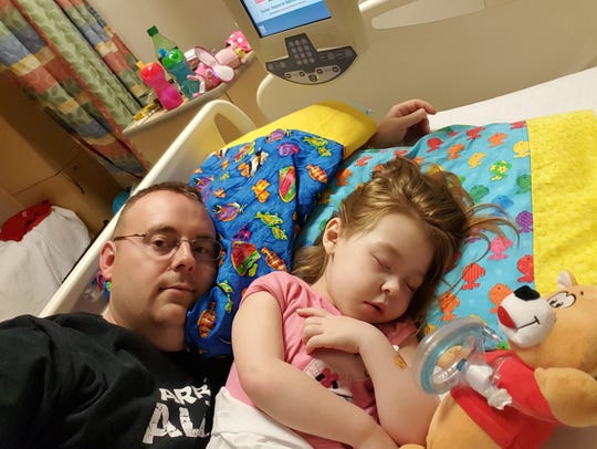 Shane Ribbing and his daughter in the St. Louis Children's