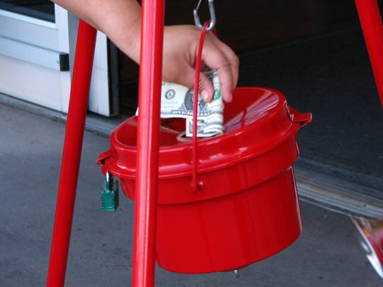 A passerby donates to The Salvation Army kettle in 2011.