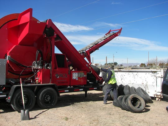 South Central Solid Waste Authority workers load a tire shredder with tires dropped off Jan. 30, during  the Chaparral Dumpster Day cleanup at Colquitt Park. Dumpster Day is a Doña Ana County Codes Enforcement free event.