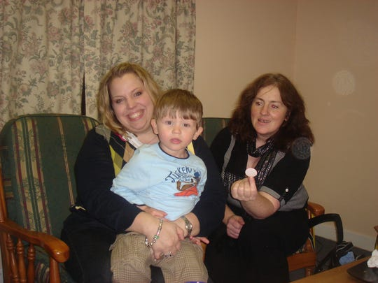 Rachel Hester, left, with Austin and his original social worker, Mary Griffin, in Ireland