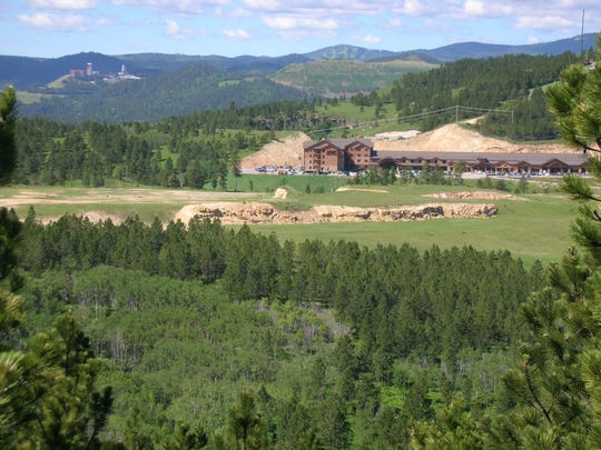 Ramkota Cos. bought land next to and across the highway from its The Lodge at Deadwood casino resort.