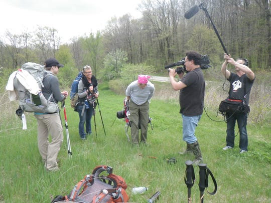 The Outdoor Wisconsin Film Crew films, from left, cancer survivors Stacey Hand, Teresa Konz, and Chris Meyer, who participated in a 3-day hike of the Ice Age Trail.