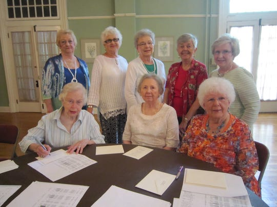 Getting ready for the centennial celebration of the Woman's Club of Murfreesboro are, seated, from left, Lacy Wakid, Margaret Scott and Jan Alexander; and standing, Frances Earl, Barletta Dagley, Joyce Fullerton, Marie Miller and Diane Summar.