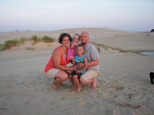 A photo of Jennifer Kubicek, her husband Joseph, and