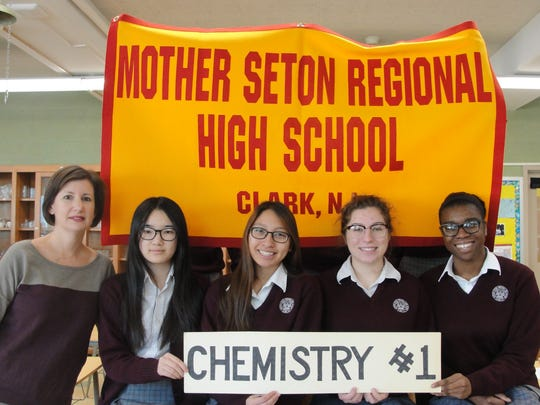 Chemistry #2.  Left to right:  Jamie Cunningham, Chemistry Teacher, Li Yuan Huang,                                             Camille Martinez, Jillian Frost, Abigail Pepe